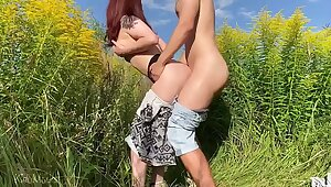 Sex with russian wife on a catch field with flowers. Public place